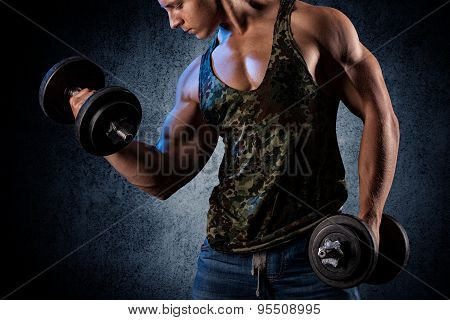 Closeup Of A Handsome Power Athletic Man Bodybuilder Doing Exercises With Dumbbell.