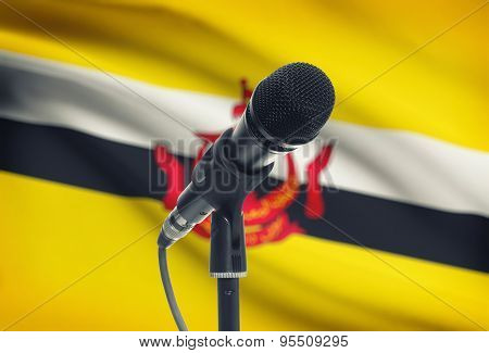 Microphone On Stand With National Flag On Background - Brunei