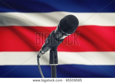 Microphone On Stand With National Flag On Background - Costa Rica