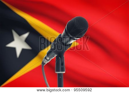 Microphone On Stand With National Flag On Background - East Timor