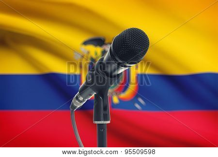 Microphone On Stand With National Flag On Background - Ecuador