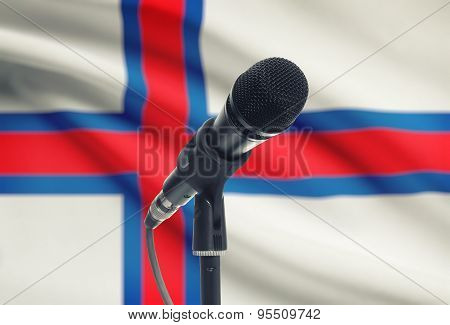 Microphone On Stand With National Flag On Background - Faroe Islands