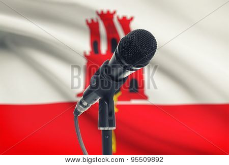 Microphone On Stand With National Flag On Background - Gibraltar