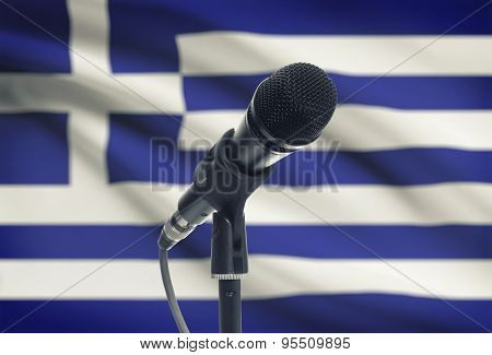 Microphone On Stand With National Flag On Background - Greece