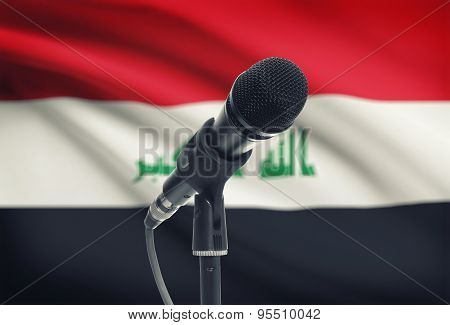 Microphone On Stand With National Flag On Background - Iraq