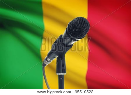 Microphone On Stand With National Flag On Background - Mali