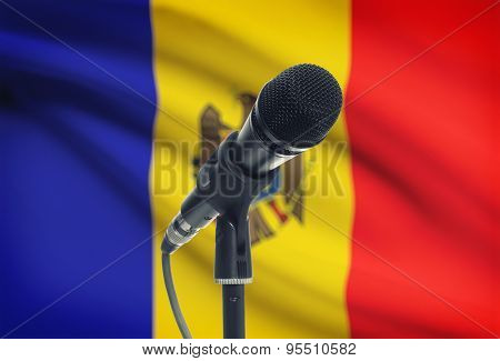 Microphone On Stand With National Flag On Background - Moldova