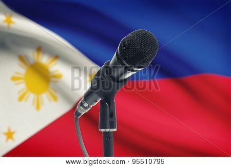 Microphone On Stand With National Flag On Background - Philippines