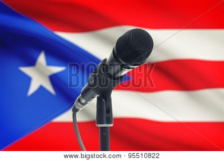 Microphone On Stand With National Flag On Background - Puerto Rico