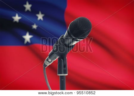 Microphone On Stand With National Flag On Background - Samoa