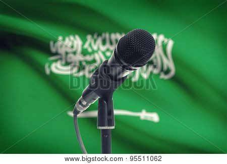 Microphone On Stand With National Flag On Background - Saudi Arabia