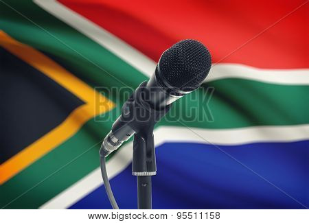 Microphone On Stand With National Flag On Background - South Africa