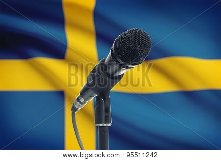 Microphone On Stand With National Flag On Background - Sweden