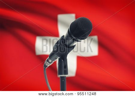 Microphone On Stand With National Flag On Background - Switzerland