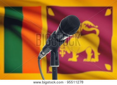 Microphone On Stand With National Flag On Background - Sri Lanka