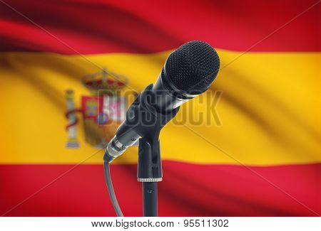 Microphone On Stand With National Flag On Background - Spain