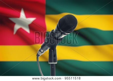 Microphone On Stand With National Flag On Background - Togo