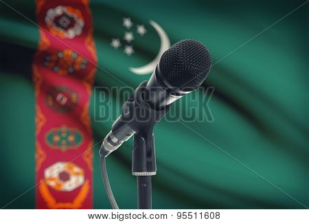 Microphone On Stand With National Flag On Background - Turkmenistan