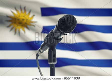 Microphone On Stand With National Flag On Background - Uruguay