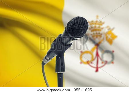 Microphone On Stand With National Flag On Background - Vatican City
