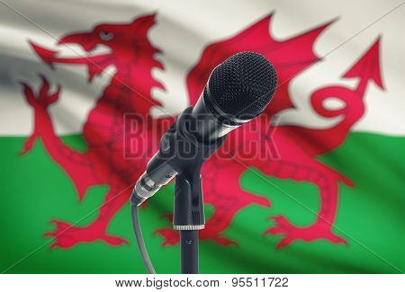Microphone On Stand With National Flag On Background - Wales