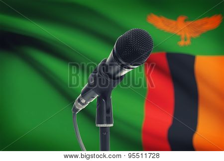 Microphone On Stand With National Flag On Background - Zambia