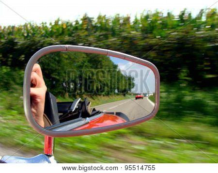 View In The Rearview Mirror Of A Car