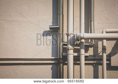 Pipeline water detail at industrial building wall
