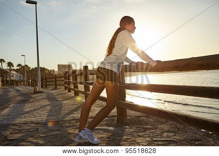 Young Jogger Exercising On The Coastline