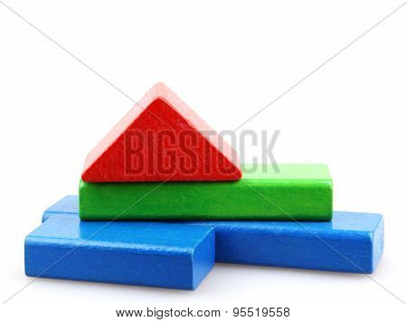 Building from wooden colourful childrens blocks - Color image.