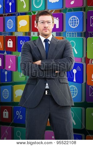 Frowning businessman looking at camera against green background with vignette