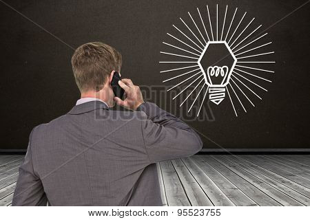 Back turned businessman on the phone against dark room
