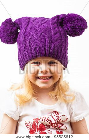 Beautiful little girl in funny knitted hat