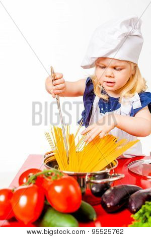 Blonde hair girl plaing  cook