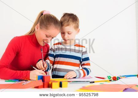 Woman drawing with her son