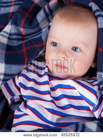 Close up of little boy wrapping in plaid