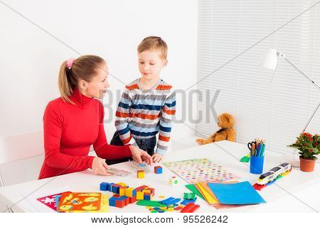 preschooler child playing with his mom