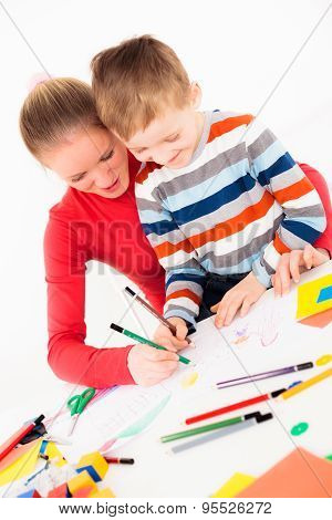 Woman drawing picture with child