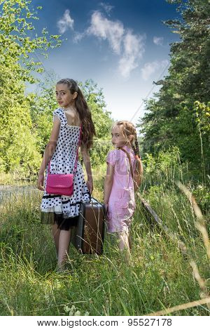 Two Happy Girls With Suitcase On Railways