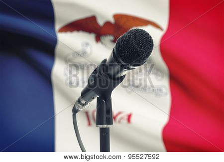 Microphone On Stand With Us State Flag On Background - Iowa