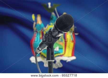 Microphone On Stand With Us State Flag On Background - New York