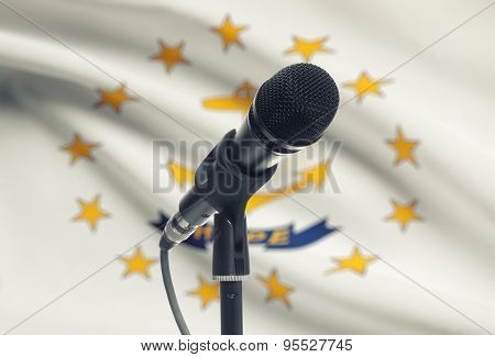 Microphone On Stand With Us State Flag On Background - Rhode Island