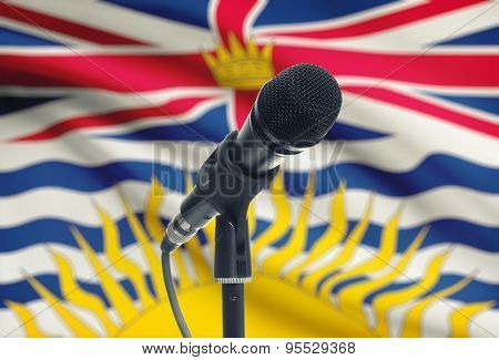 Microphone On Stand With Canadian Province Flag On Background - British Columbia