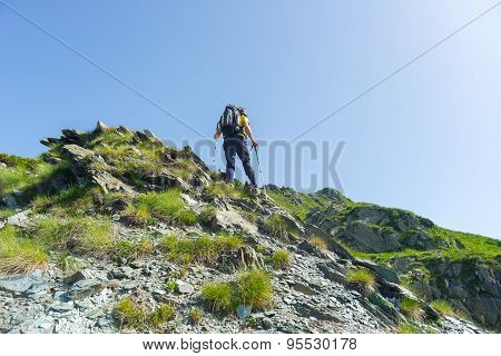 Mountain Climbing On Steep Rocky Slope