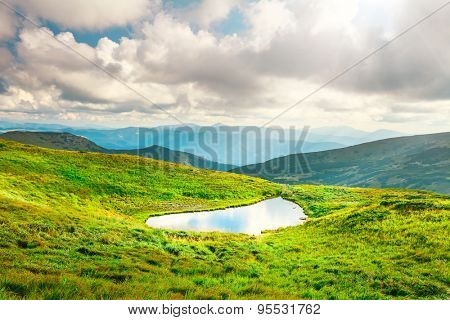 Alpine lake Brebeneckul on summer mountain ravine (Ukraine, Chornogora Ridge, Carpathian Mountains).