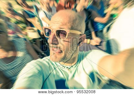 Bald Funny Man Taking A Selfie In The Crowd With Stupid Tongue Out Expression - Travel Lifestyle