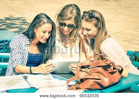 Young Hipster Girlfriends Studying And Having Fun Together With Tablet - Social Interaction
