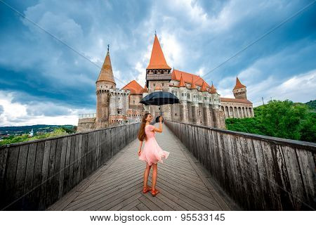Female tourist near the Corvin castle