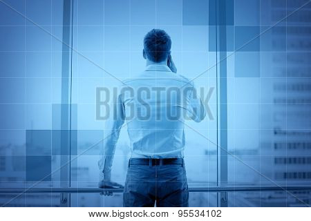 business, technology and people concept - businessman calling on smartphone and looking out office window behind monochrome blue grid