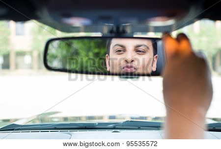 Guy Checking Himself Out In Rearview Mirror